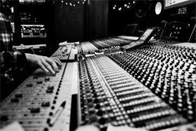 This photo was allegedly taken while recording Passion Pit's album, but it really could be from any studio ever.