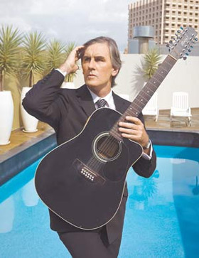 Robert Forster serenading, poolside