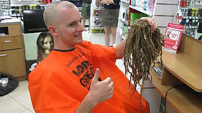 Andrew McMillen has his dreadlocks shaved off for the Leukaemia Foundation's World's Greatest Shave